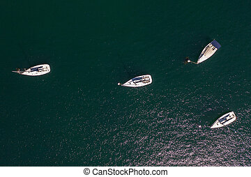 white sailing yachts in the sea top view