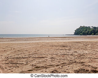 Sand on beach with sea and sky in Thailand