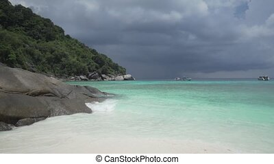 White sandy tropical beach over beautiful sea and cloudy sky...
