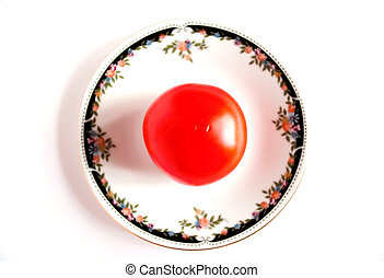 White saucer with a red tomato. - White saucer with a red...