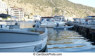 white sea boat in the bay