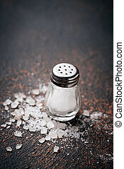 White sea salt on rusty background. Top view