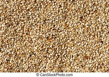 White sesame seeds background.