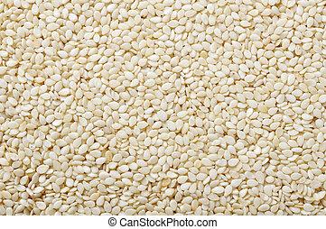 white sesame seeds closeup as a background