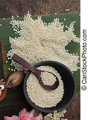 White sesame seeds organic on wood background