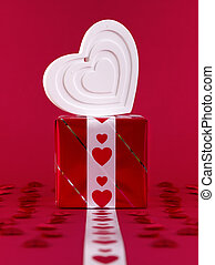 White shape heart over gift box