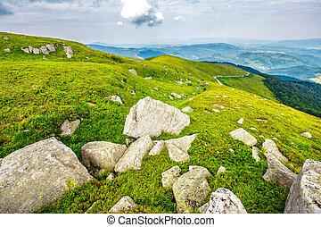boulders on the hillside - white sharp boulders on the...