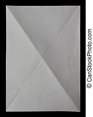 white sheet of paper diagonaly folded in four on black