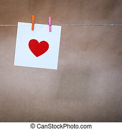 paper with a red heart
