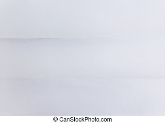 white sheet of textured paper folded in three