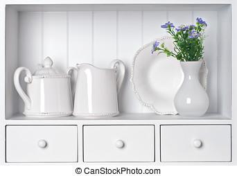 White shelf with vintage porcelain tableware