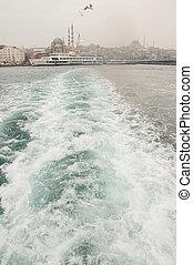Bosphorus - white ship sails along the Bosphorus in Istanbul...