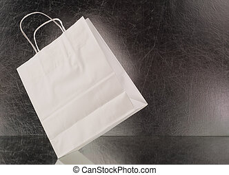 white shopping bag on a black background