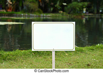 White sign in a peaceful lake.