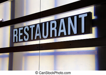 white signboard with the word restaurant in the window