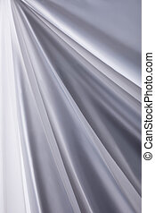 white silk cloth waves background texture close-up