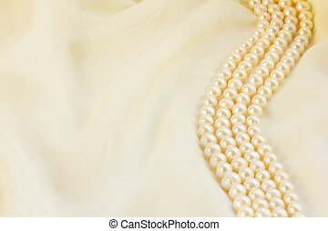white silk with pearls