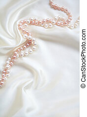 White silk with white and pink pearls as wedding background