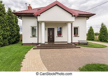 White single-family house - Shot of an entrance to a white...
