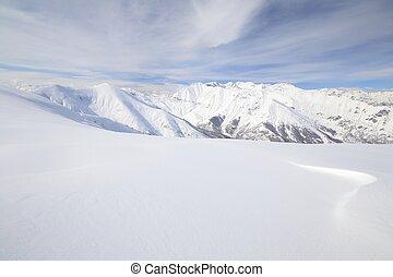 White ski slope - Candid off-piste ski slope in scenic...