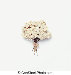 White small bouquet of dried flowers isolated on a white background