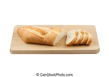 White small bread being cut on wooden board