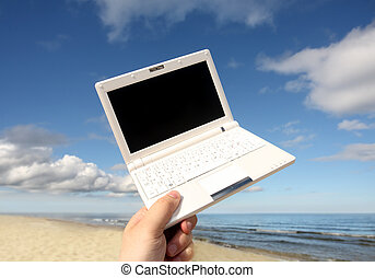 White small  Laptop on the beach