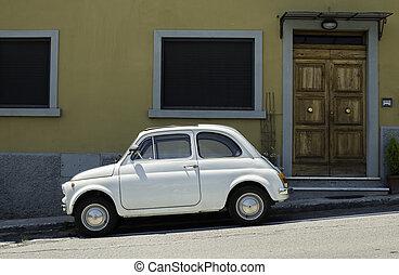 White small vintage Fiat Abarth. Sin light