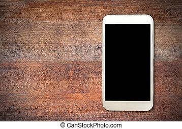 White smart phone on wooden desk