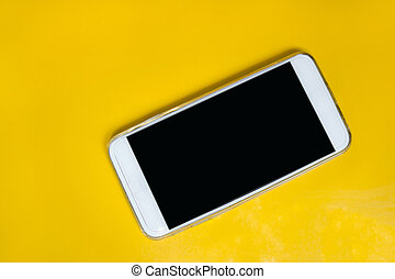 white smart phone on yellow table
