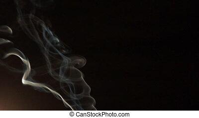 white smoke on a black background