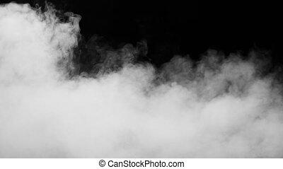 White Smoke on Black Background - White clouds of vapor...