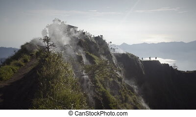 White smoke rise up from top of volcano