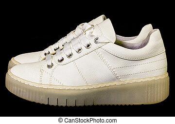 White sneakers on black