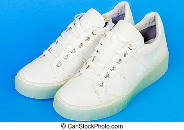 White sneakers on blue background