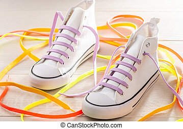 White sneakers with violet shoelaces