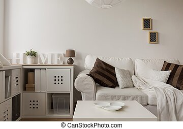 White sofa and brown cushions in living room
