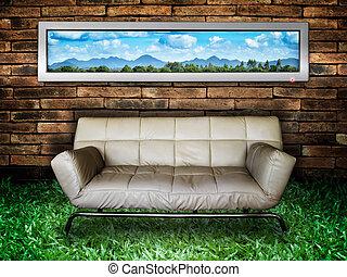 White sofa Brick Wall and Green Grass