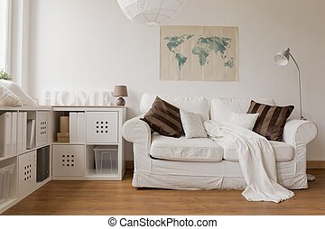 White sofa in living room - White sofa and commode in cozy...