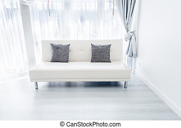 white sofa in room