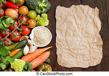 White sorghum grainl with vegetables and craft paper on wood