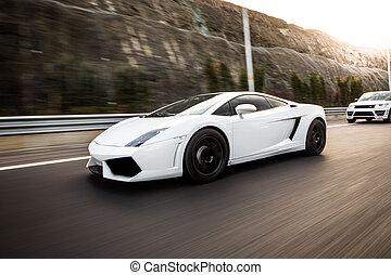 White sport model car on the highway