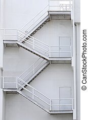 White stairs of a building for emergencies.