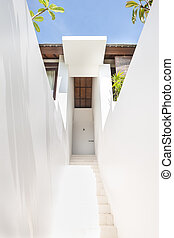 White stairs, through the walls to a modern mansion