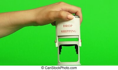 White stamp drop shipping. Close up. Green screen