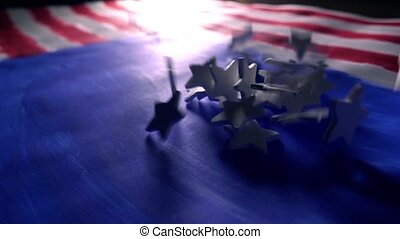 White stars falling on painted American flag, the symbol of the USA. Super slow motion video