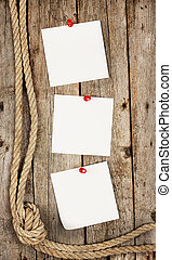 White stickers on wooden background