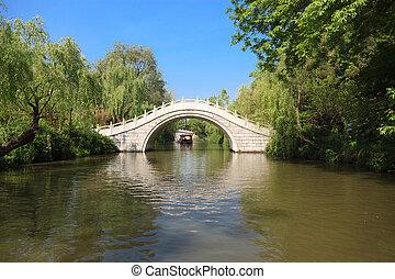 White stone footbridge in an Asian garden - White stone...