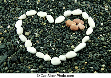 white stone forming love shape