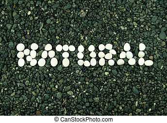 white stone forming natural word